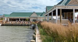 A green roofed building by the docks of Ocean City