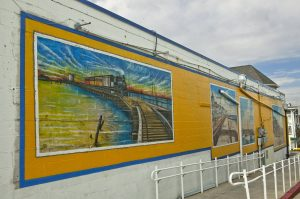 A Mural of trains and the boardwalk in Ocean City