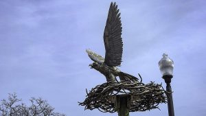 A Sculpture of a Sea Hawk in a nest